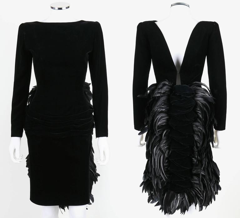 Vintage Oscar de la Renta cocktail dress from the Autumn/Winter 1987 collection. Plunging v-cut back. Back of skirt is embellished with a black coq feather and ruffled velvet bustle. Dress has long sleeves which zip at the cuffs. Padded shoulders.