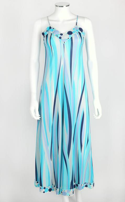 Vintage c.1960s Emilio Pucci for Formfit Rogers two piece maxi dress/lounge set in shades of blue and gray. Spaghetti strap slip dress. Circle decorative border on v-neckline and hem. Over-dress has long raglan sleeves with button detail at cuff.