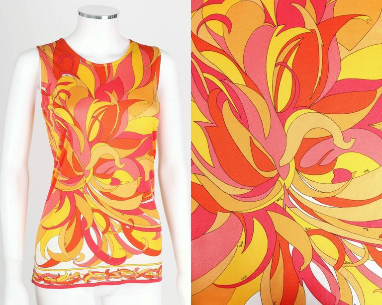 Vintage c.1970s Emilio Pucci orange, red, pink, yellow and white multicolor silk blend jersey top. Abstract chrysanthemum motif signature print. Sleeveless. Round neckline. Slip-on style. Please note that this item was pinned to better fit our