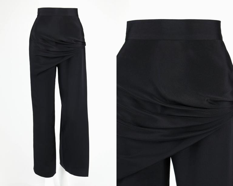 Vintage c.1990's Gianni Versace Couture black silk pants. Drape front, gathering at the right hip. Open slit on the outside pant leg. Closes in back with zipper, hooks/eyes and one button. Marked Fabric: