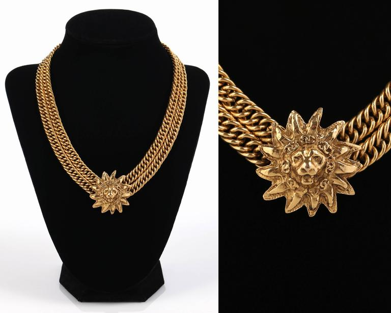 Vintage early c.1980's Chanel CC logo Lion sun gold tone double chain necklace.  Lion head sun pendant is mounted on center of double chunky curb chains measures approximately 1 1/4