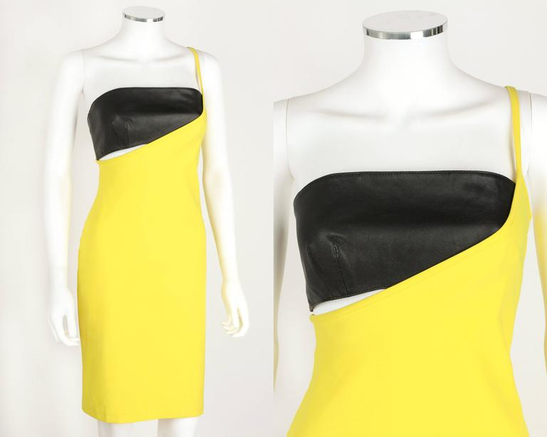 Versus Gianni Versace c.1990's yellow bodycon dress and leather bandeau top set. Single left side spaghetti strap. Pullover style. Black genuine leather bandeau top is fully lined and zips at left side. Knee length. Original tags attached. Please
