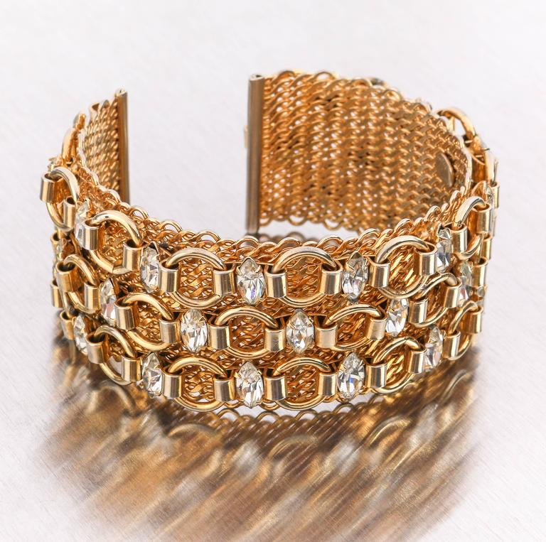 Vintage c.1960's Hattie Carnegie gold tone mesh and chain link cuff bracelet with marquise cut crystal colored rhinestones. Wide mesh cuff measures approximately 1 1/4