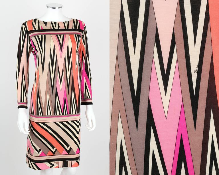 Vintage c.1960's Emilio Pucci multicolor zigzag signature print silk jersey shift dress. Decorative border detailing around bust, cuffs, drop waist, and hem. Wrist length sleeves. Bateau neckline. Unmarked Fabric Content: