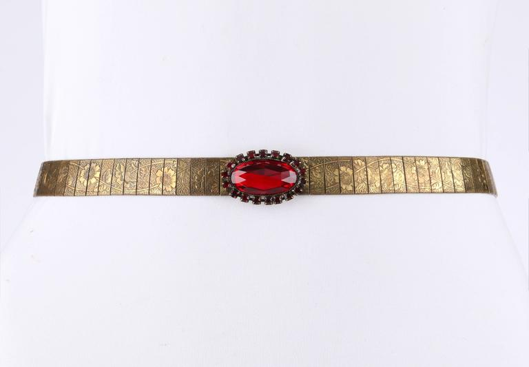 """Vintage c.1930's Victorian Revival bronze tone mesh/link belt with faux ruby colored faceted cabochon stones and beads. Belt has bronze links carved with detailed floral design. Five large oval faceted ruby colored cabochon stones (1.5"""" L x 1"""" W)"""