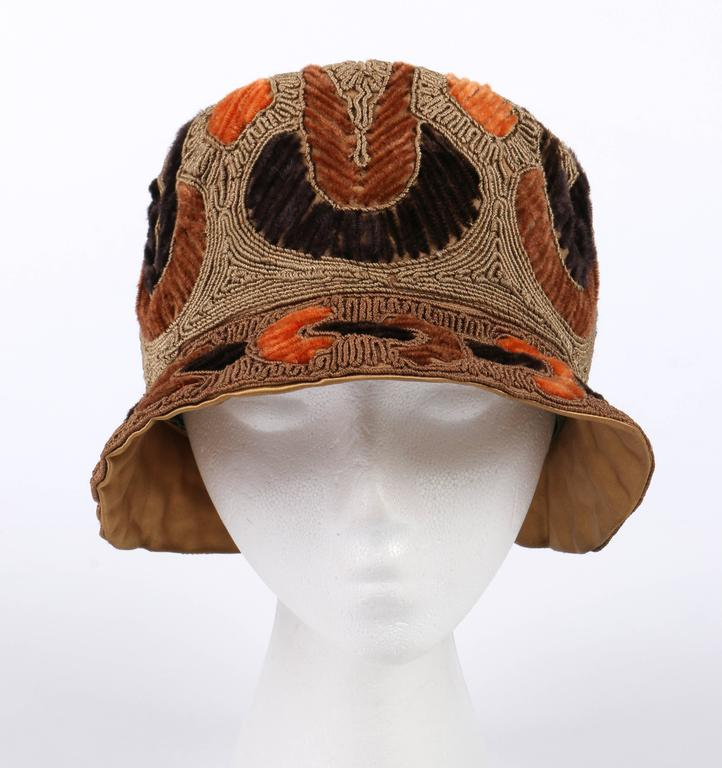 Vintage couture c.1920's Rich Art Models by Felsenthal Hat Co. gold and bronze heavily corded/embroidered flapper cloche hat. Heavily embellished with gold bullion thread on body and bronze bullion thread on brim. Brown, dark brown and orange