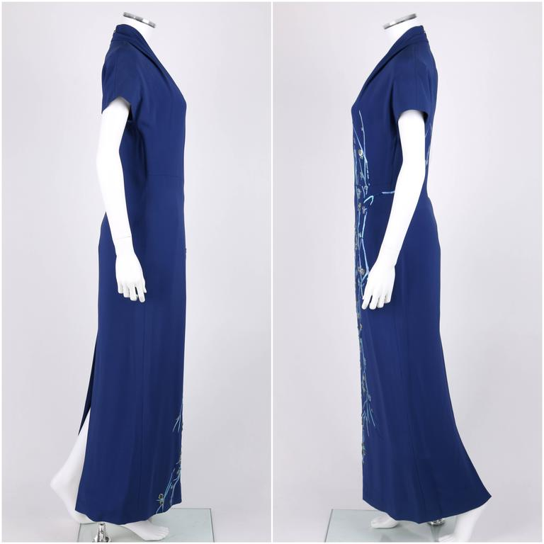 Givenchy Couture A/W 1998 royal blue evening dress designed by Alexander McQueen. Floral embroidery in shades of blue with clear glass beads and silver sequins. Short dolman sleeves. V-neckline. Center back invisible zipper with hook and eye