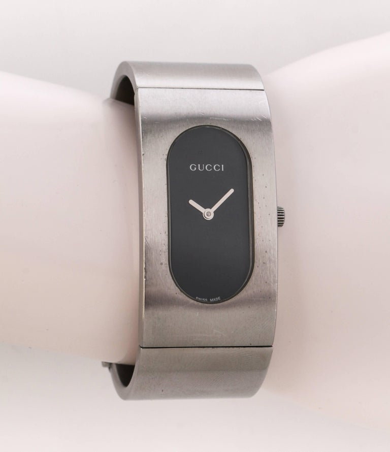 f0548091a85 Gucci 2400L black oval dial stainless steel ladies bangle bracelet watch.  Black oval dial set