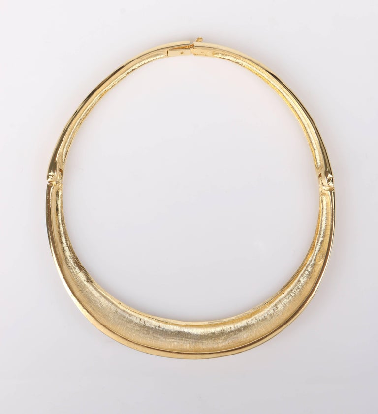 Vintage Lanvin c.1970's gold-toned metal and crystal rhinestone modernist collar choker necklace. Designed by Jules-François Crahay. Polished gold-toned collar has silver crystal rhinestone segment at left front. Segment is separated at the middle