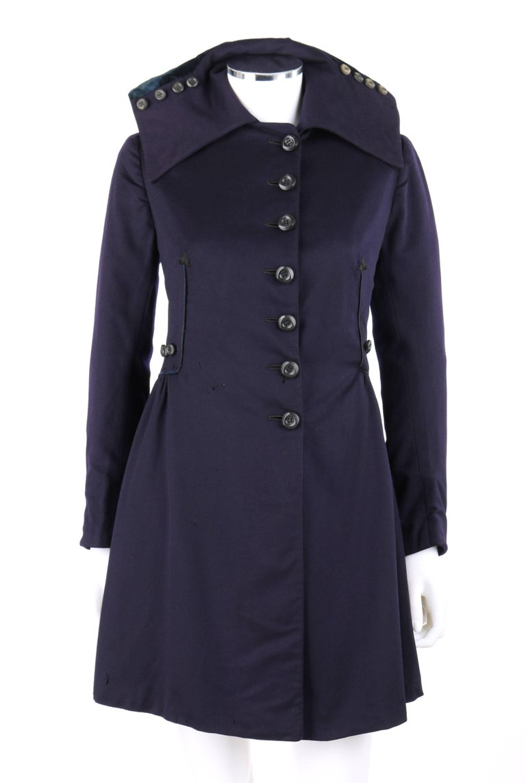 Vintage Edwardian couture c.1910's navy blue wool military-cut walking coat. Wide flat collar with four button detail on either side and flounced dark teal blue silk velvet at back. Seven side front button closures from neckline to hips. Long