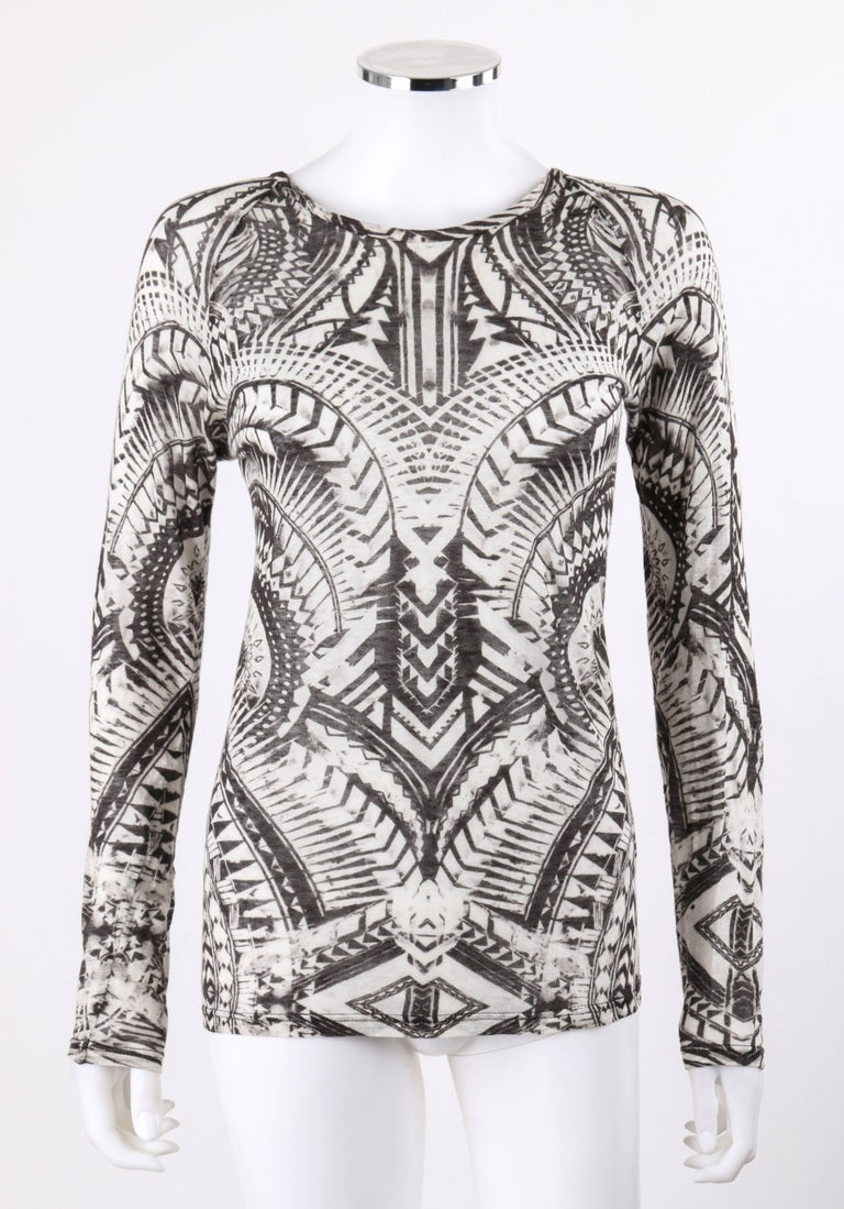 Balmain Resort 2012 black and white abstract print linen knit scoop neck top. Designed by Olivier Rousteing. Faded black and white abstract mirrored print knit. Scoop neck. Long raglan sleeves. Pull over style. Marked Fabric Content: