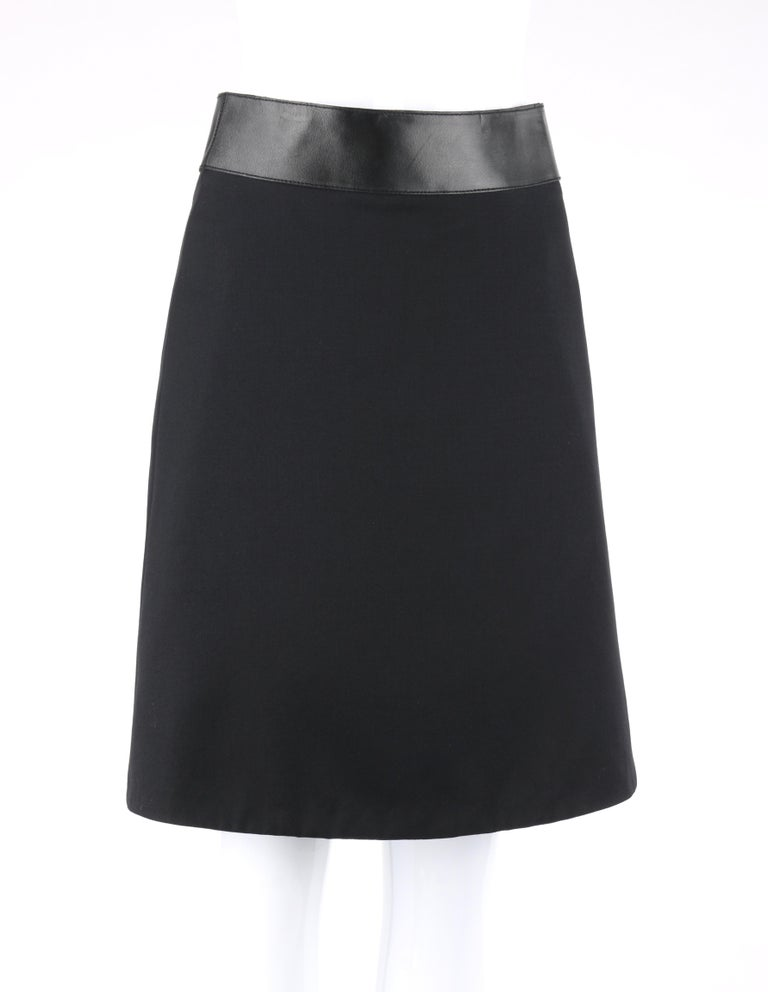 DESCRIPTION: GUCCI Pre-Fall 2014 Black Wool Gabardine Leather Waistband Classic A-Line Skirt   Brand / Manufacturer: Gucci Collection: Pre-Fall 2014 Designer: Frida Giannini Manufacturer Style Name:  Style: A-line skirt Color(s): Black Lined:
