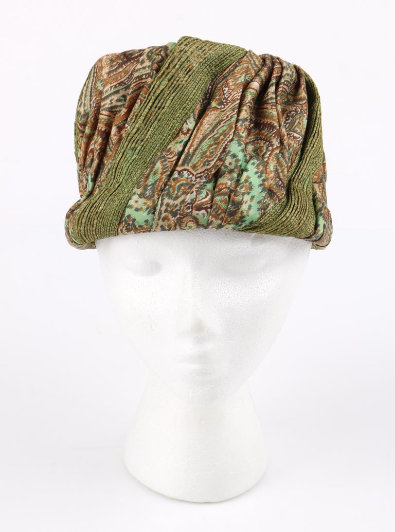 DESCRIPTION: Miss Dior by CHRISTIAN DIOR c.1960s Green Paisley Print Silk & Straw Pleated Toque Hat   Circa: c.1960's Label(s): Miss Dior Created by Christian Dior; United Hatters, Cap, and Millinery Workers union label Style: Toque hat Color(s):