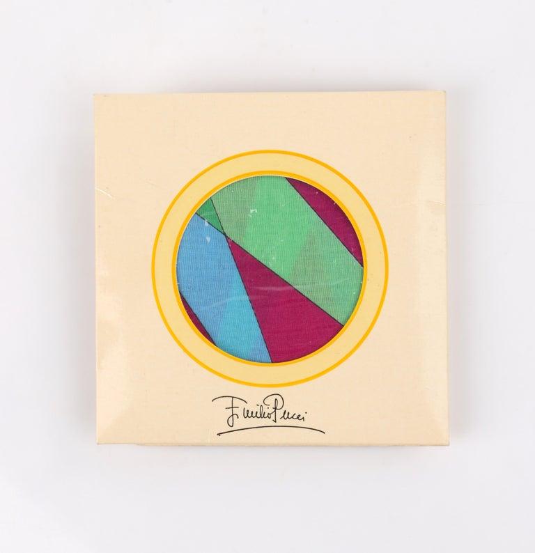 DESCRIPTION: EMILIO PUCCI c.1970's Sunburst Signature Print Square Scarf / Handkerchief NOS    Circa: c.1970's Label(s): Emilio Pucci Style: Scarf / Handkerchief Designer: Emilio Pucci Color(s): Multi in shades of magenta, green, blue, and