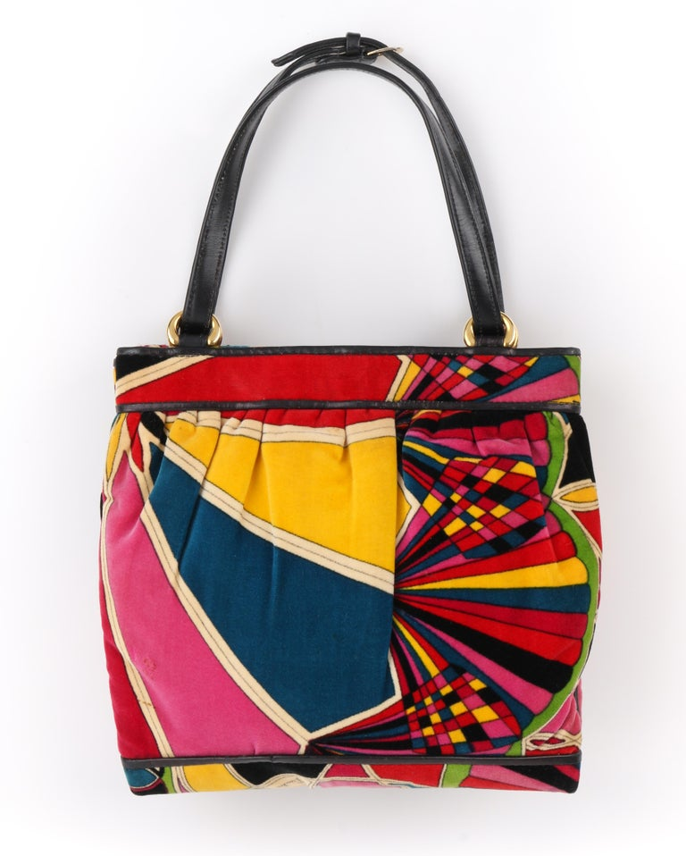 DESCRIPTION: EMILIO PUCCI By Jana c.1960's Stained Glass Signature Print Velvet Purse   Circa: c.1960's Label(s): Emilio Pucci Bags By Jana Designer: Emilio Pucci Style: Top handle purse Color(s): Multi Lined: Yes Marked Fabric Content:  Unmarked