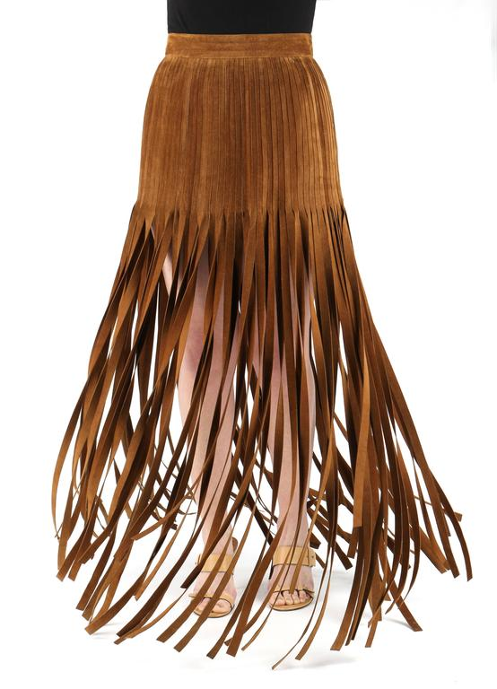 "Vintage  c.1970's Hermès Paris brown calfskin suede mini skirt with long suede fringe. Fringe is cut at various lengths. Skirt closes at back with zipper and button. Fully Lined. Marked Fabric Content: ""Calf Skin"" ;  Lining: ""60%"