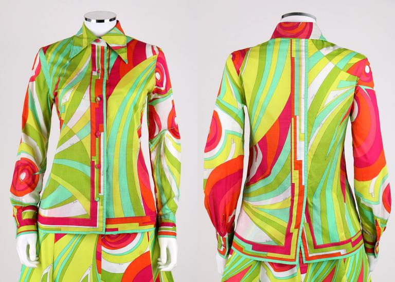 Vintage c.1970s Emilio Pucci green multi-color abstract signature print three piece cotton set. Light weight long sleeve button down shirt with button detailing at cuff. Pointed collar. Center back vent. Cotton jersey halter top buttons at back of