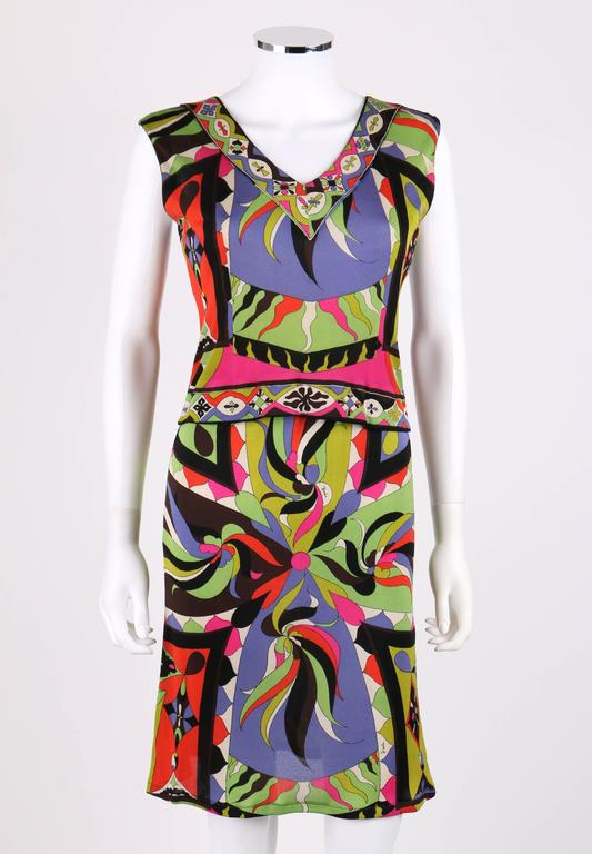 Vintage c.1960s Emilio Pucci multi-color abstract signature print silk jersey two piece set. Sleeveless v-neckline top/shell with decorative border on neckline and hem. Center back button closure. Straight skirt with elastic waistband.  Marked
