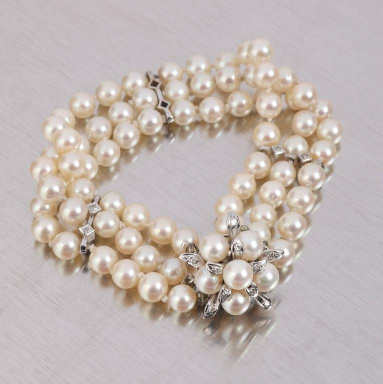 Vintage c.1950's Cultured Pearl 3 strand bracelet with 14 kt white gold clasp and spacers. Pearls have a creamy white color with a subtle rose tone (measure approximately 6 to 6.5 mm). The bracelet is divided into 2 sections of 24 pearls, 2 sections