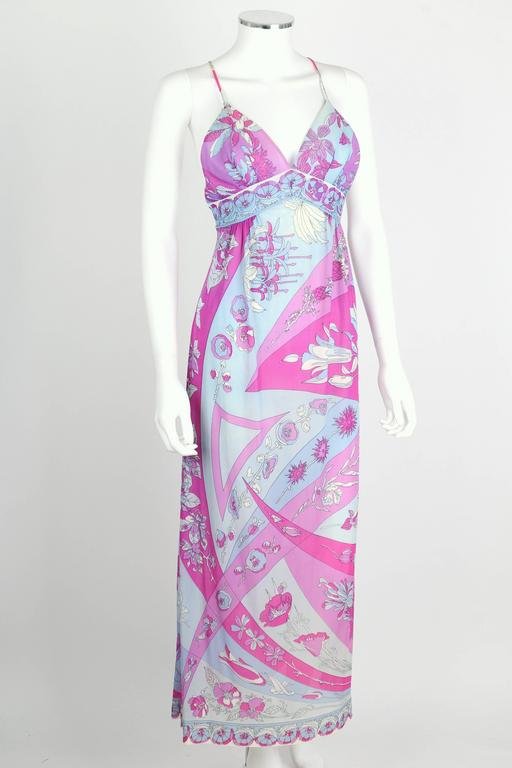 Vintage c.1970's Emilio Pucci for Formfit Rogers floral print long slip maxi dress in shades of pale blue, purple and magenta. Spaghetti straps. Low scoop back with cross strap detailing. Empire waistline. Deep v-neckline. Decorative floral border