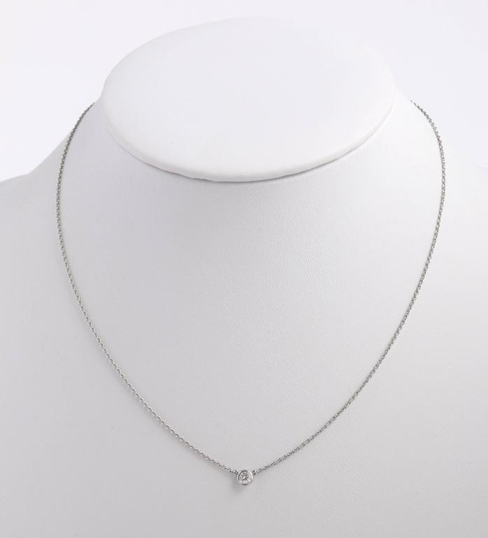 """Tiffany & Co Elsa Peretti """"Diamonds by the Yard"""" platinum necklace and earring set. Platinum cable chain (approximately measuring 16.5"""" L, including clasp) with round bezel set diamond (approximately measuring 2.5mm). Carat weight 0.05ct ."""