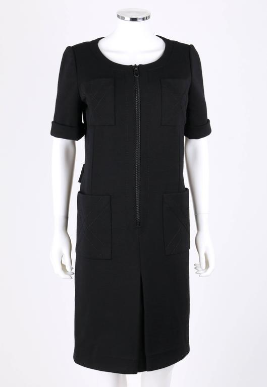 Vintage c.Early 1960's Jean Patou by Karl Lagerfeld black wool mod shift dress. Round neckline. Short sleeves with cuff detailing. Four large pockets, two on chest and two on hips, with