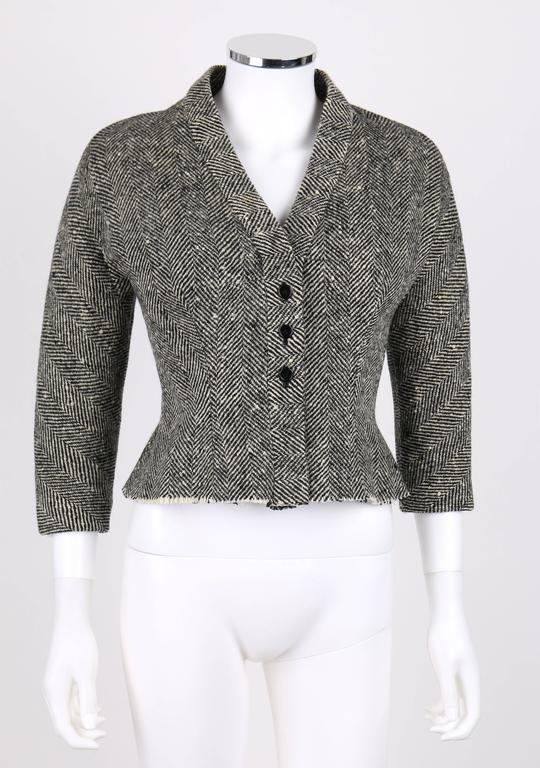 Vintage Hubert de Givenchy c.1952, very early work, black and cream herringbone structured silhouette wool jacket. Hand written couture number