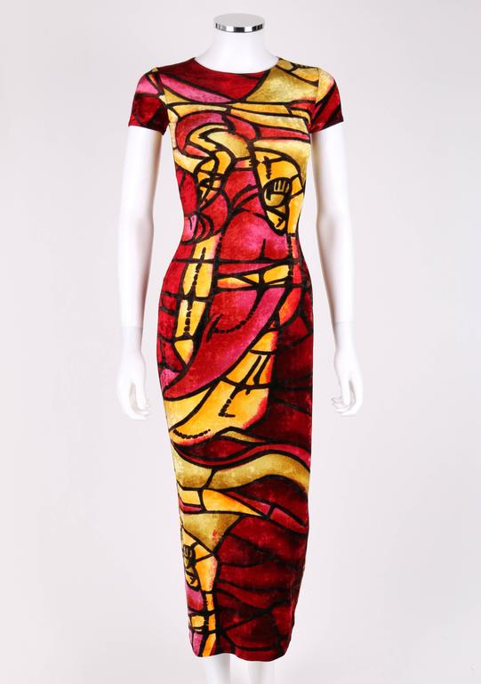 Christian Dior c.late 1990's designed by John Galliano multicolored stained glass print crushed velvet dress. Round neckline. Short sleeves. Bodycon midi style. All over stained glass print in shades of yellow, pink and deep red. Stretch silk