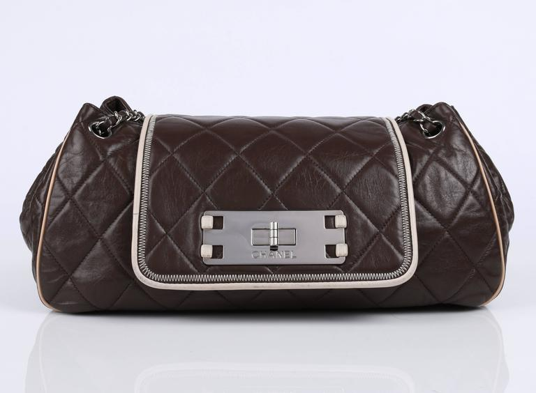 """Chanel S/S 2008 """"East West"""" accordion flap front purse. Brown lambskin leather quilted in classic diamond pattern. Contrasting ivory leather piping and zig zag stitch detail. Silver-toned chain link strap with entwined brown leather laced through"""