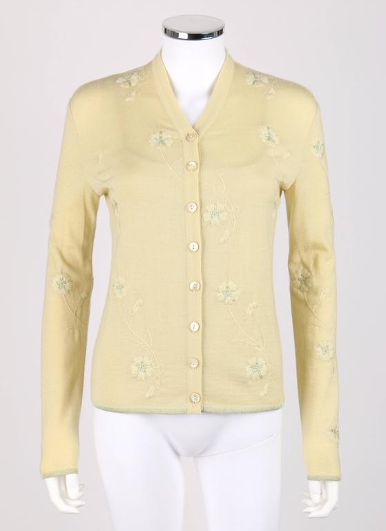Givenchy Couture S/S 1998 designed by Alexander McQueen pale yellow cardigan tank top set. Pale yellow and metallic floral embroidered knit. Eight center front button closures. Round pearlescent yellow buttons with etched Givenchy logo. V-neckline.