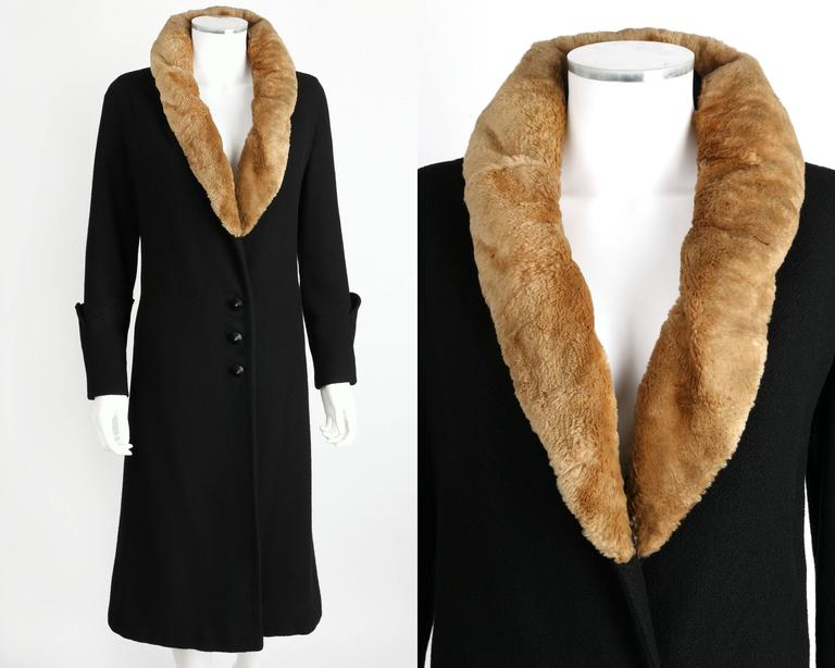 Vintage c.1910's Edwardian coat Fashioned by Miller.  Black wool. Quilted embroidered sculptural art deco detail cuffs with two button detail. Three center front button closures. Black cone shaped buttons. Tan genuine sheared beaver fur shawl