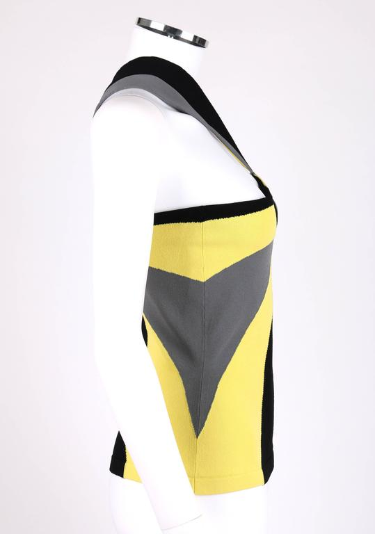 """Alexander McQueen Resort 2010 knit tank top. Runway look #19. Yellow, black, and gray starbust op art pattern. Sleeveless. Two stylistic halter style straps. Marked Fabric Content: """"83% Rayon 17% Polyester"""". Marked Size: """"S""""."""