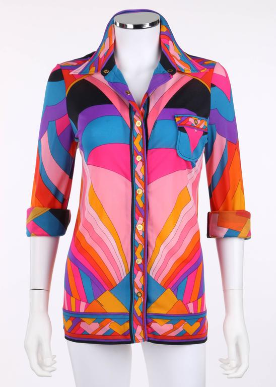 Vintage Leonard Fashion c.1973 knit blouse exclusively sold at Bergdorf Goodman. This blouse was purchased and owned by Vivien M. Weiden (wife of Norman Weiden, retired Senior VP of Merrill Lynch). Bright multicolor geometric signature print in