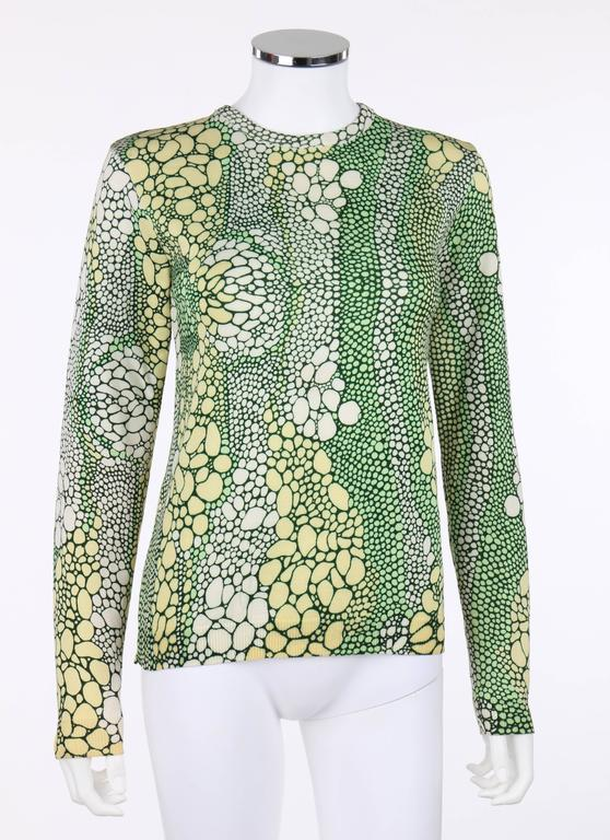 Vintage Givenchy Sport c.1970's green mutlicolor reptile print top. All over reptile print in shades of cream, light yellow, and green. Crew neckline. Long sleeves. Rib knit trim around collar, cuffs, and hemline. Pull over style. Unmarked Fabric