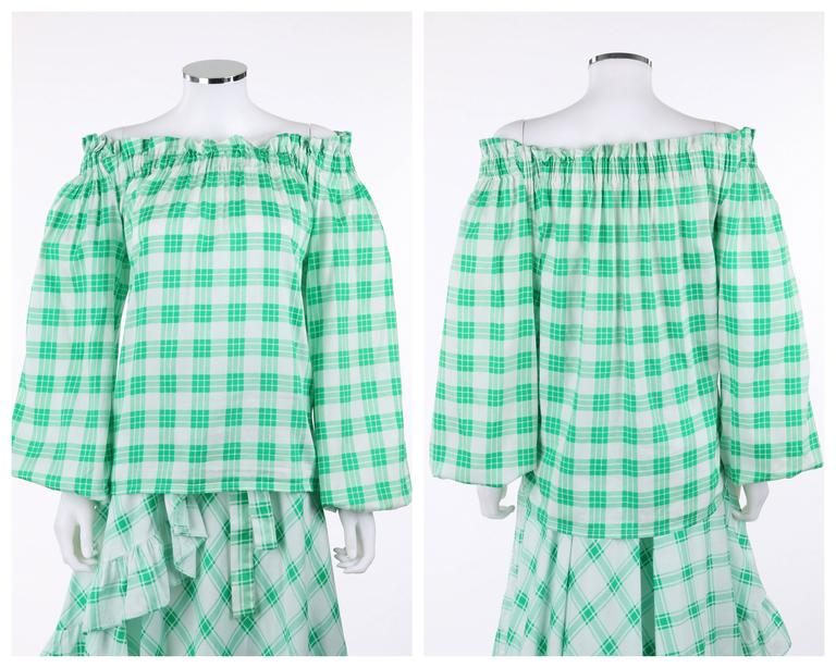 Vintage Yves Saint Laurent YSL Spring / Summer 1978 two piece peasant blouse and wrap skirt dress set. Green and white cotton plaid peasant blouse. Gathered elastic off-shoulder neckline. Long peasant sleeves with gathered elastic cuff. Matching