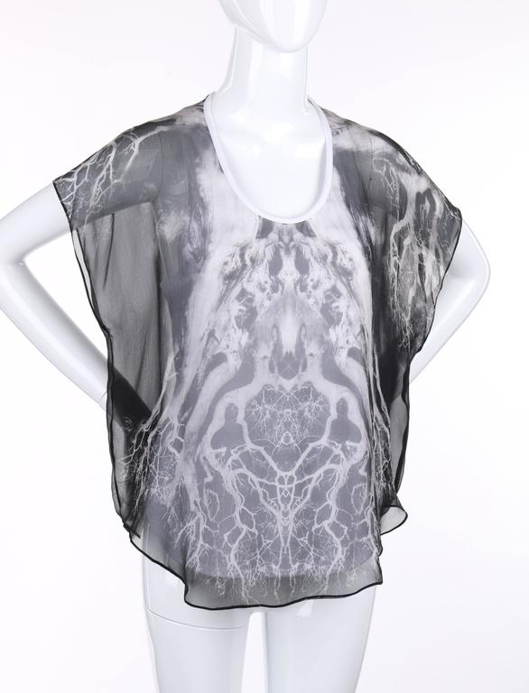 """Alexander McQueen c.2010 """"Tree Print"""" silk chiffon blouse. Silk chiffon overlay with black and white abstract tree print. Short dolman sleeves. Scoop neckline. White cotton racer back tank top underlay. Marked Fabric Content: """"Fabric"""