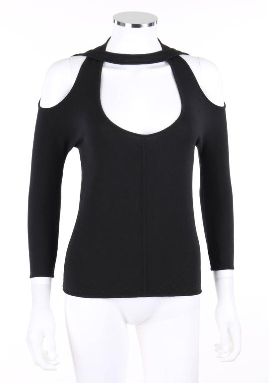 """Alexander McQueen S/S 2002 black open/cold shoulder top. From Alexander McQueen's """"Dance of the Twisted Bull"""" collection. Low scoop neckline. 3/4 length sleeves. Open shoulder. Cross over neckline which wraps in front and behind neck. Thin"""