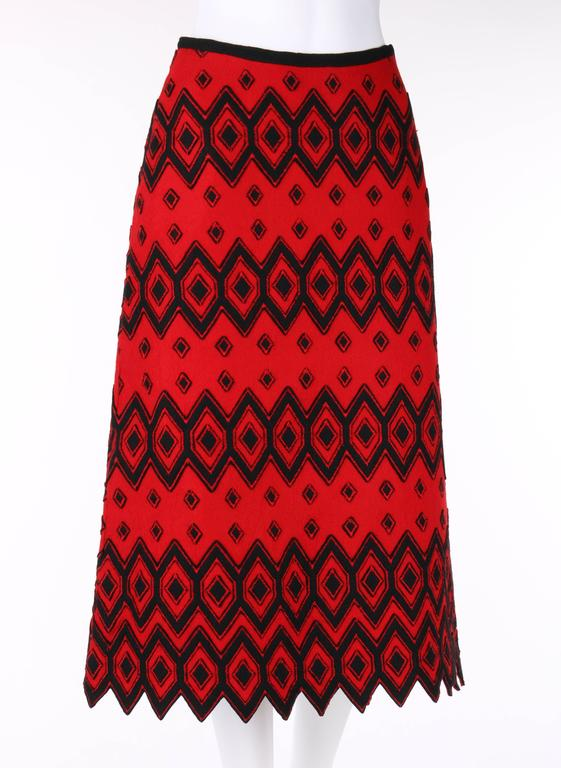 Vintage Anne Klein c.1970's (designed by Donna Karan) red & black wool felt a-line skirt. Black diamond pattern applique with red zigzag stitch detail. Shark tooth hemline. Left side seam zipper with hook and eye at top. Fully lined. Unmarked Fabric