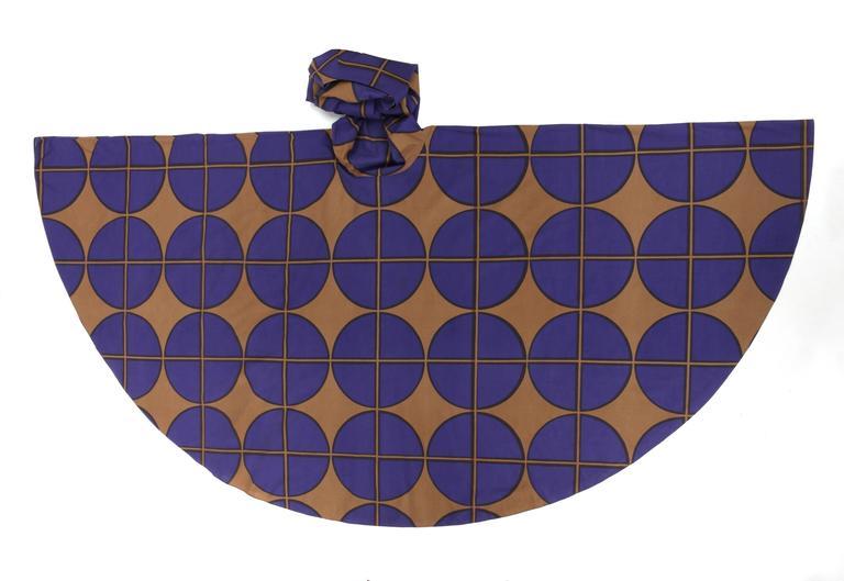 Vintage Marimekko c.1971 cotton maxi dress. Purple & brown large circle windowpane print. Long raglan angel sleeves. Scoop neckline. Drop waist. Bias cut full circle skirt. Partially lined at sleeves. Slip-on style. Marked Fabric Content: