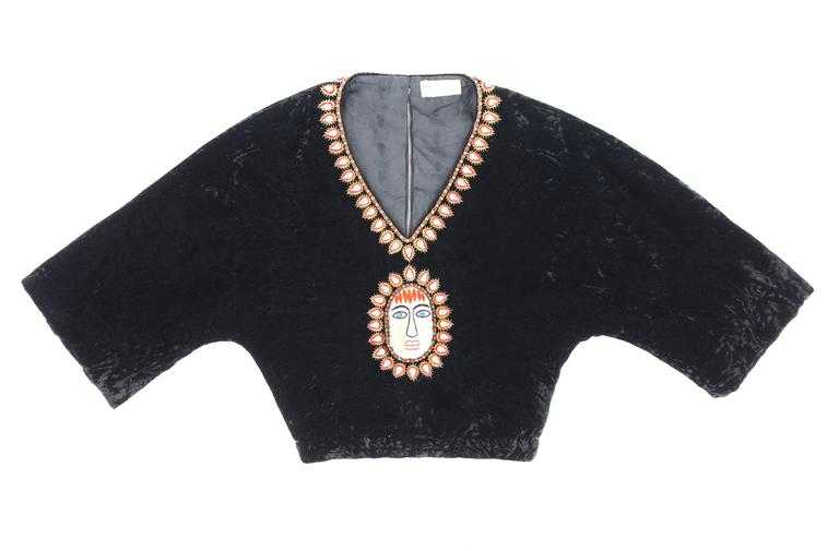 Extremely rare vintage Gucci c.1970's black crushed velvet cropped blouse. Bohemian beaded and embroidered detail at neckline and center front made up of blue and red rounded glass beads, faceted tear drop crystals with red and gold surrounding