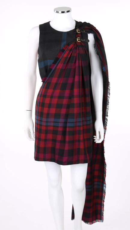 Gucci Autumn/Winter 2008 red and blue tartan plaid kilt shift dress; new with tags. Tartan plaid in shades of red, burgundy, black and blue. Sleeveless shift style. Scoop neckline. Two adjustable black leather straps with gold-toned buckles at left