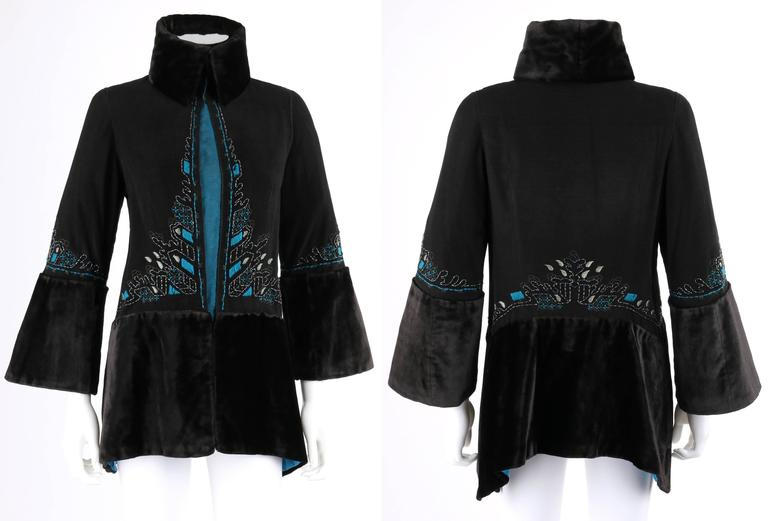 Vintage c.1910's Edwardian Couture one of a kind black & peacock blue / teal wool embroidered jacket. Embroidered detail along center front, waistline, and sleeves in shades of teal, etc., with black beaded embellishment. 3/4 length bell sleeves