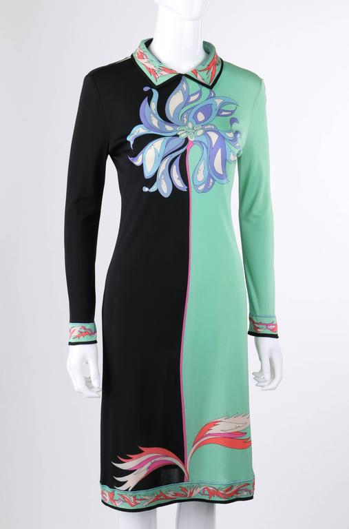 Vintage Emilio Pucci c.1970's mint green & black color-block silk jersey dress. Large floral print in shades of blue, green, and white at center front and sleeves. Botanical boarder print in shades of pink at hemline, sleeve cuffs, collar, and