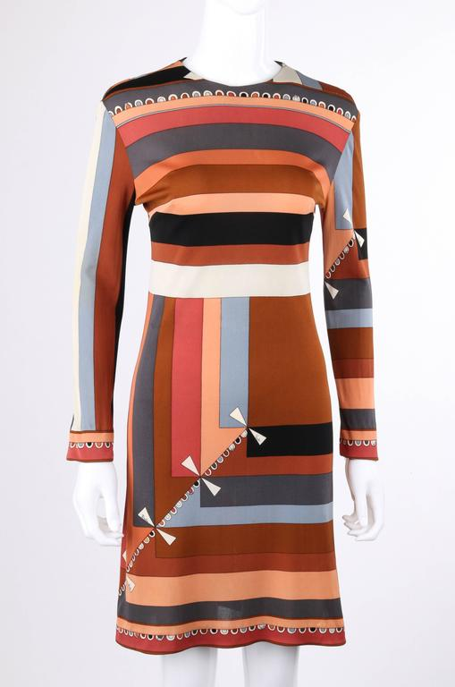 """Vintage Emilio Pucci exclusively for Saks Fifth Avenue c.1968 """"Celletti"""" print silk jersey shift dress. Multicolor geometric print in shades of brown, gray, peach, and black with a scallop and brown boarder print across top of front,"""