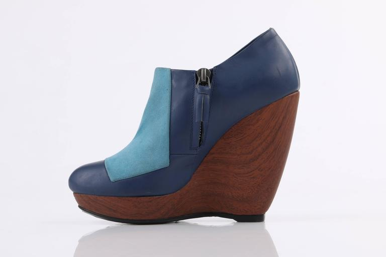 Balenciaga light on dark blue colorblock wooden wedge heels; New without box. Blue matte finish genuine leather upper with light blue suede front panel. Side zip closure with navy leather zipper pull. Leather lined. Brown wooden platform wedge.