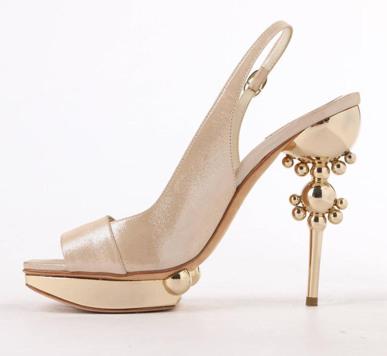 Christian Dior Resort 2008, designed by John Galliano, beige metallic suede sculpted heel platform sandals; New without box. Runway look #37. Beige metallic dot suede upper. Square peep toe. Sling back with adjustable strap and gold-toned oval