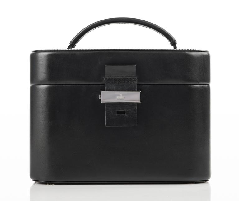Gucci black genuine leather structured train case/cosmetic travel bag. Single flat double rolled handle. Leather tab and silver-toned metal latch top. Interior removable leather backed mirror secured to top of lid with leather strap and slide pocket