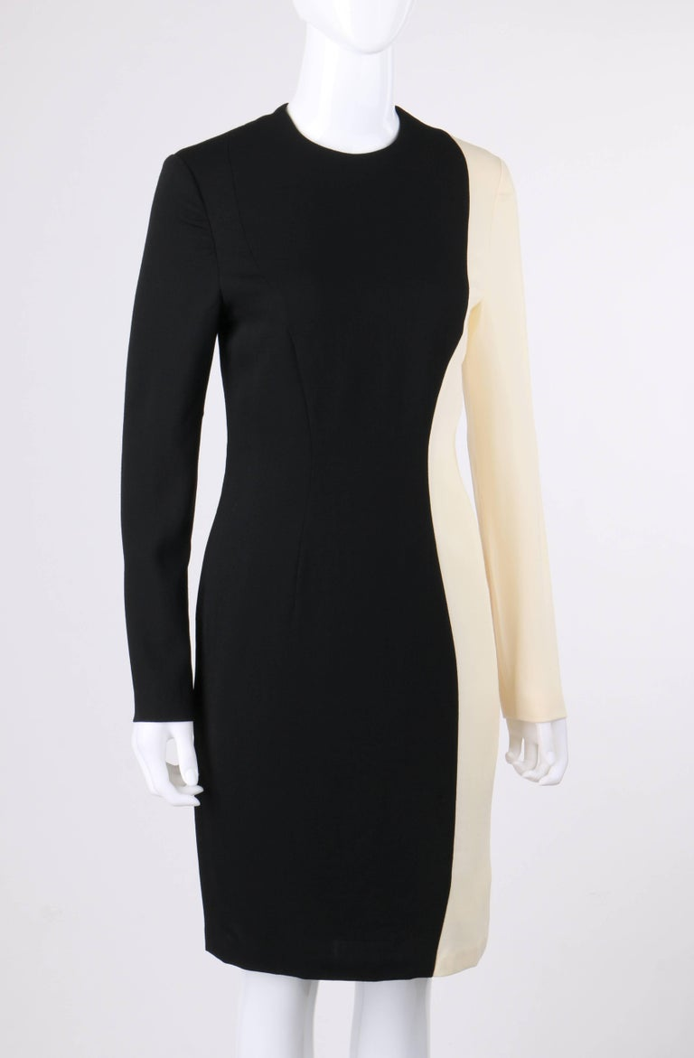 Vintage Pierre Cardin c.1980's black and ivory color-block wool cocktail dress. Long sleeve shift style. Crew neckline. Stylized curved princess seams. Center back zipper closure. Center back slit. Partially lined. Marked Fabric Content: