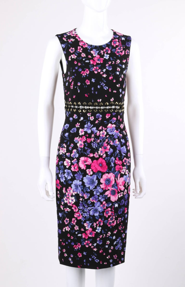 Versace Spring/Summer 2012 Black multi-color floral print cut out waist shift cocktail dress; New with tags. Multi-color all over floral print in shades of pink and purple on black. Scoop neckline. Sleeveless shift style. Cut out waist detail made