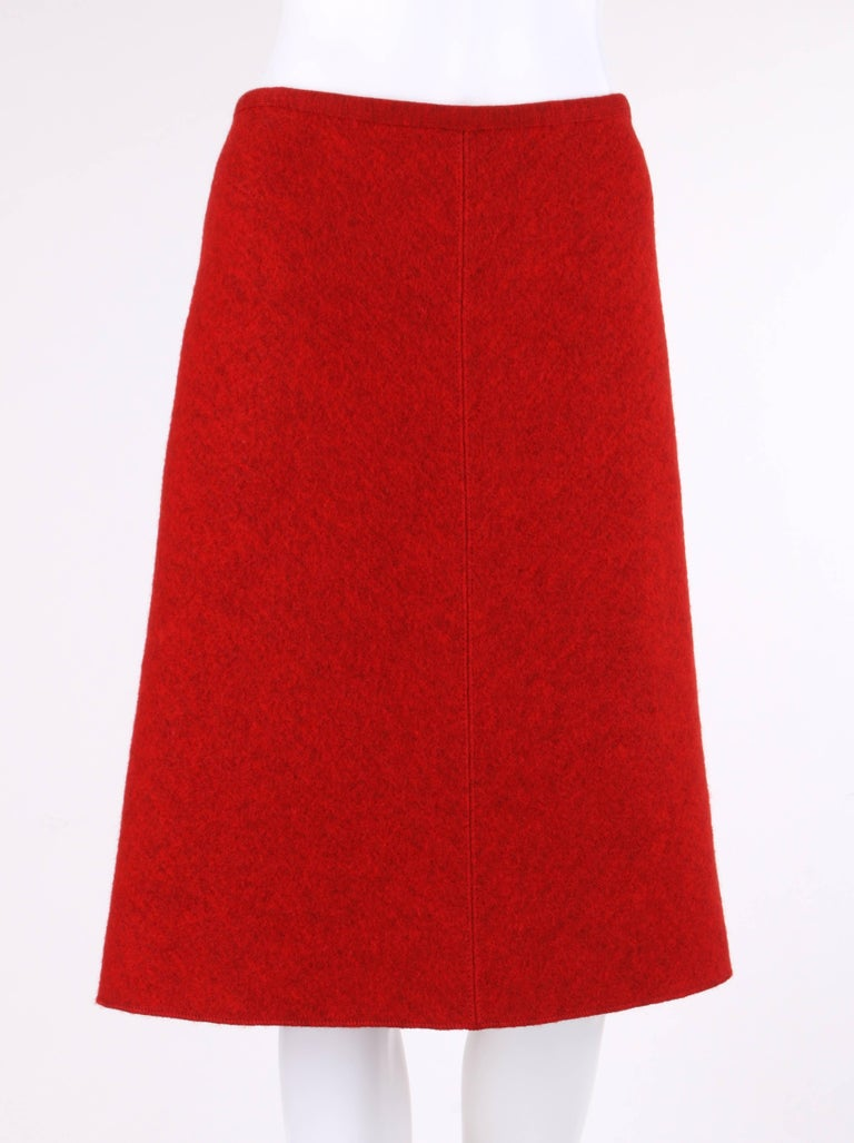 Alaia c.1990's red boiled wool a-line skirt. Four paneled skirt. Rib knit bound waist. Two front and back angled waistline darts. Tonal top stitch detail. Unlined. Marked Fabric Content: